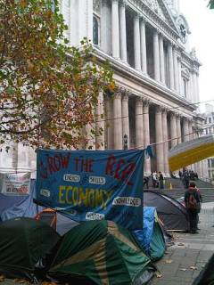 grow the real economy occupy london protest st pauls cathedral england roadsofstone